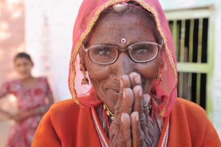 A woman from India with a gesture of thankfulness.